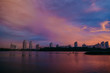 View of the city center midtown silhouette from the river at color sunset. text place