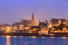 Beautiful Cityscape Of The Skyline Of Antwerp, Belgium, During The Blue Hour Seen From The Shore Of The River Scheldt, With Castle Het Steen And St. Paul's Church