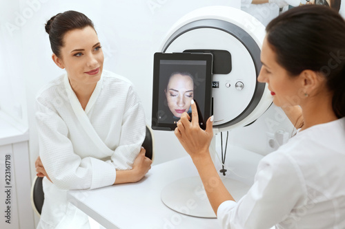 Photo Face Skin Analyze. Cosmetologist Analyzing Woman Facial Skin