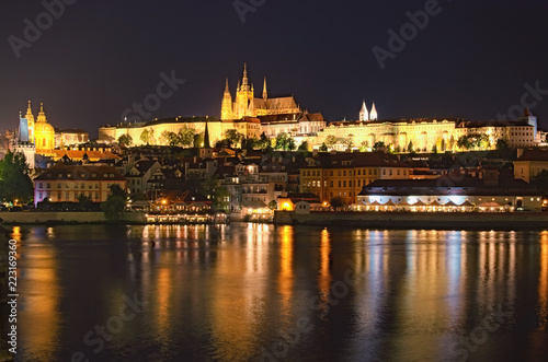 Poster Prague Summer night view of old Prague. Vltava river, Charles Bridge with illumination and Prague Castle with amazing Saint Vitus Cathedral. Prague, Czech Republic