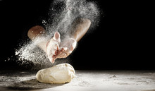 Chef Clapping His Hands To Dust Dough With Flour