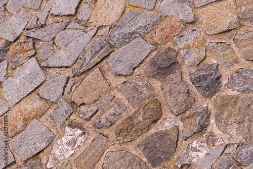 Fotografia  beige uneven asymmetric stones lime cemented part of the natural wall of the old