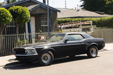 Side View Of A Classic Vintage American Muscle Car In The Street