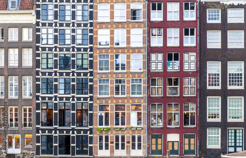 Foto op Canvas Oude gebouw Urban background with residential building windows in Amsterdam, Netherlands