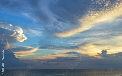 Fototapeta Clouds at dusk over ocean obraz na płótnie