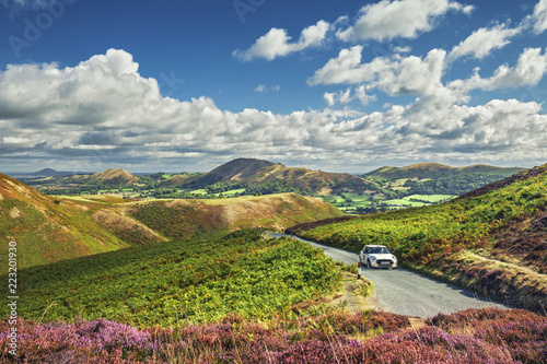 Canvas Prints Hill White Car on the Top of Scenic Hill with Amazing View