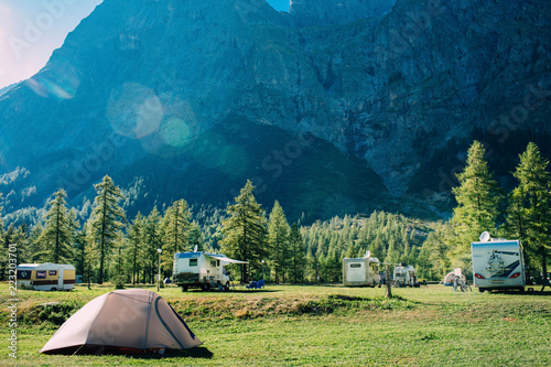 In de dag Kamperen tourist tent in mountains camping at Italy, active resting