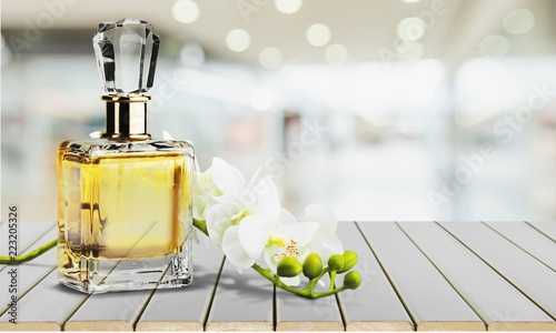 Fototapeta Perfume bottle and flowers isolated on  background. obraz