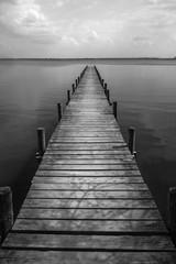 Panel Szklany Współczesny Wooden pier at silence lake, monochrome shoot