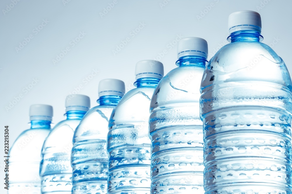 Fototapety, obrazy: Six Water Bottles in a Row on the Blue Background
