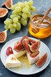 Cheese brie with figs,grape and honey.