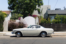 Side View Of A Classic Vintage  Car In The Street
