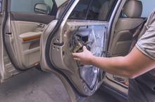 Car Mechanic Repairs The Door ...