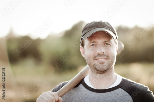 Photo  Vintage Style Portrait of a Happy Baseball Player