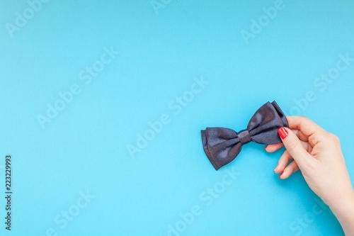 Obraz Black bow tie woman hand for men fathers concept - fototapety do salonu