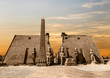 Leinwanddruck Bild - Entrance to Luxor Temple at sunset, a large Ancient Egyptian temple complex located on the east bank of the Nile River in the city today known as Luxor (Thebes). Was consecrated to the god Amon-Ra