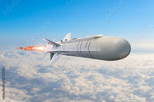 Photo Rocket launch with fire clouds, large rocket with fire and engines flying in the sky aimed at the target