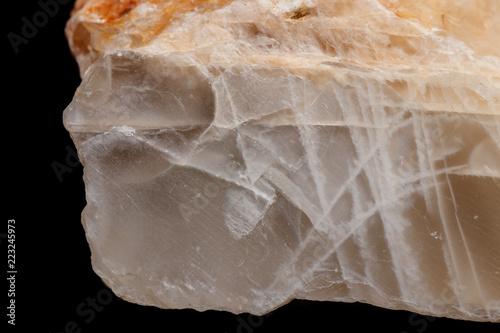 Fényképezés Macro mineral stone Moonstone a black background