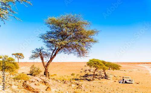 Photo  Abonded car in the Sahara desert next to M'hamid - Morocco