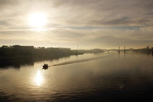 Misty Dawn Over The Town And River