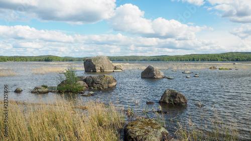 Foto op Aluminium Blauw view of big rocks in päijänne lake in summer