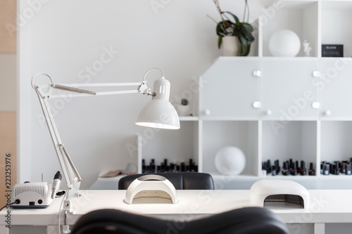 Interior studio for nail care. White room for manicure with a lamp and a tool