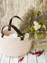A Bouquet Of Summer Wildflowers In A Wicker Basket
