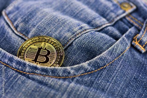 Fotografie, Obraz  bitcoin coin in a blue jeans pocket