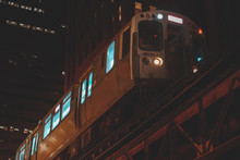 Low Angle View Of A Train On  Chicago Loop At Night, Illinois, United States