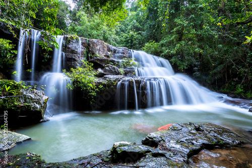 Poster Watervallen Pang Sida waterfall during rainy season. The beautiful waterfall in deep forest at Pang Si Da National Park, Srakaew Thailand