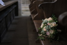 Bouquet Of Roses On A Bench In...