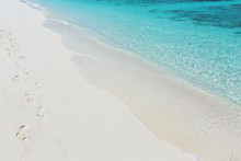 Footprints In Sand On A Tropical Beach, Maldives
