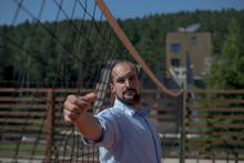 Businessman Holding A Volleyball Net, Bosnia And Herzegovina