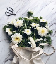 Bouquet Of White Flowers In A Linen Bag