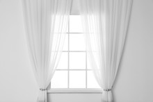 White Wall With Modern Window And Curtains Indoors. Living Room Interior