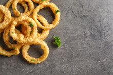 Homemade Crunchy Fried Onion Rings On Color Table, Top View. Space For Text