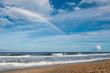 Double Rainbow on Beach with Cloudy Blue Sky