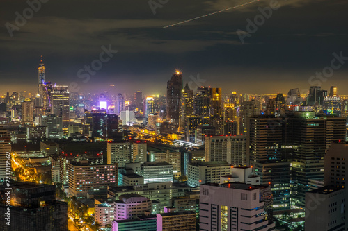 Fototapeta Aerial Bangkok Skyline Buildings around Silom Area with Iconic Condominium in the Cloudy day with light from the City. obraz na płótnie