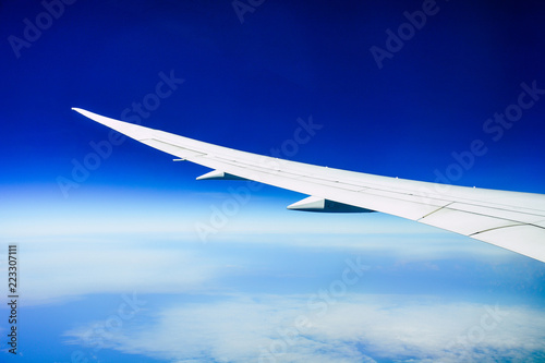 White Wing Of The Aircraft View From Airplane Window Seat Flying