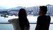 clip of couple relaxing on Cruise ship enjoying ocean view from balcony