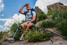 Joyful Young Man With Prosthesis Resting Outdoors