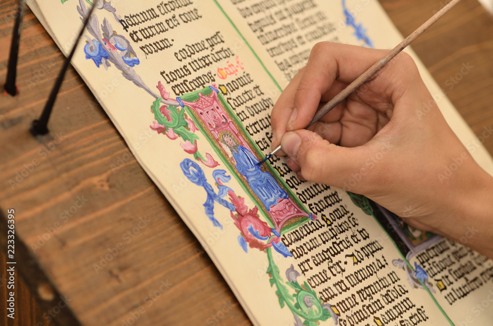 Photo Close-up of hand of medieval manuscript scribe - calligraphy