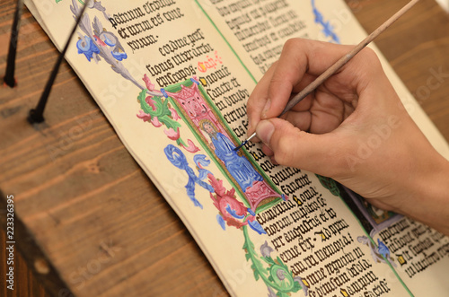 Fototapeta Close-up of hand of medieval manuscript scribe - calligraphy