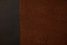 Top View Of Delicious Brown Cocoa Powder On Black Background