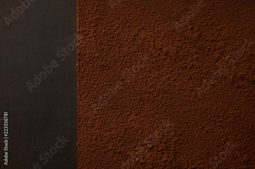 top view of delicious brown cocoa powder on black background Canvas Print