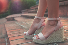 Beautiful Female Feet, Blue Nails In Light Pink Sandals On A Wedge.