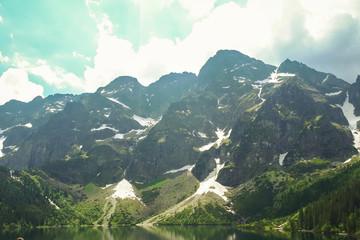 FototapetaMountain peaks against a blue sky on a sunny day. A range of Tatra mountains