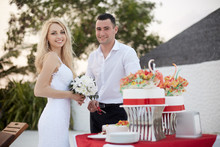 Groom And Bride Cut Wedding Ca...
