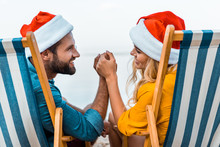Smiling Couple In Santa Hats S...