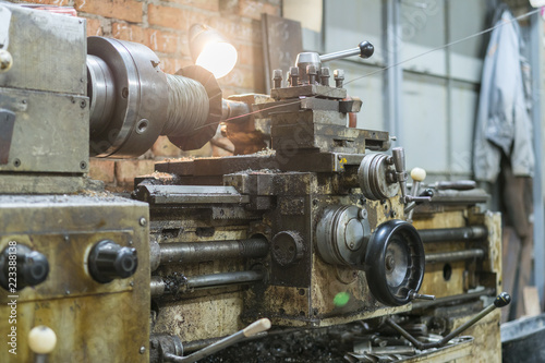 Old machinery in a factory from the mid-20th c  working